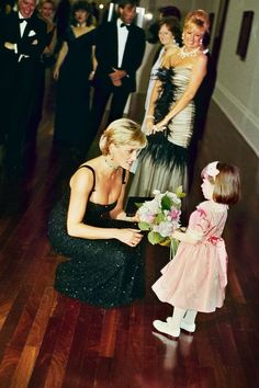 Princess Diana accepting a floral bouquet, on her 36th birthday, 1997.