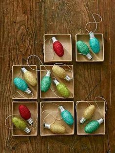 DIY Ornament Garland...old nightlights...just brush on glue, roll in glitter and let dry for 15 minutes...string together with coiled ribbon...very festive!!!