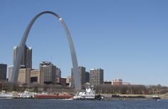 In this Nov. 12, 2012, file photo, two barges head north on the Mississippi River past St. Louis, as seen from East St. Louis. The Army Corps of Engineers has begun reducing the flow from a Missouri River reservoir, a move expected to worsen low water conditions on the Mississippi River and potentially halt barge traffic at St. Louis within weeks. (AP Photo/Jim Suhr, File)