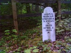 Wooden grave marker in front of a fence in a forest - Slide Cemetery Dyea, AK Soapy Smith, Emporia Kansas, Skagway Alaska, Old Cemeteries, Park Service, Cemetery, The Locals, Marker, Fence