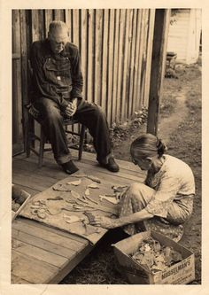 .Arranging her quilt applique pieces. What a wonderful old picture!! Love it.