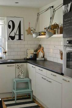 floating shelf + open storage + industrial lighting + white subway tile + chalkboard