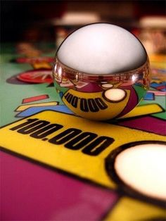 Close up of a pinball on a play deck