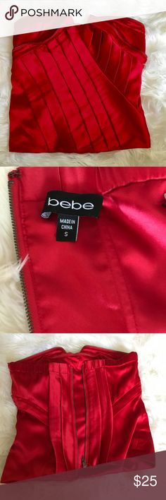 Bright red satin strapless Bebe camisole top Amazing red color Bebe camisole top cute zipper detail. Looks amazing under a navy or black suit! Worn twice... perfect also for valentines date or Christmas party. bebe Tops Camisoles