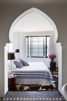 Love the alcove bedroom, the tile floors- the window- all of it