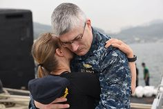 Cmdr. David Kaiser, executive officer of the Virginia-class fast-attack submarine USS Mississippi (SSN 782), greets his wife on the pier of the Republic of Korea (ROK) Fleet base during a routing port visit.