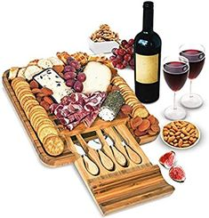 Amazon.com   Bamboo Cheese Board and Knife Set - Wood Charcuterie Board Set - Serving Meat & Cheese Board with Slide-Out Drawer for Cutlery - 4 Stainless Steel Knives and Server: Cheese Plates Cheese Trays, Meat And Cheese, Ham Delights, Cheese Board Set, Graduation Party Foods, Charcuterie Platter, Cheese Lover, Serving Utensils, Christmas Brunch