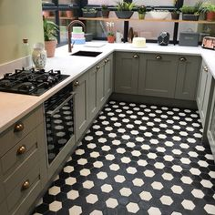 Stylish hexagon shape creates a honeycomb effect layout. Add vintage charm to your floors with these black, clay floor tiles. Black Hexagon Tile, Hexagon Tiles, Hexagon Shape, Tile Floor, Kitchen Cabinets, Victorian, Layout, Flooring, Bathrooms
