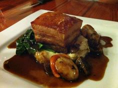 Braised pork with scallops with potato mash, mushrooms and spinach