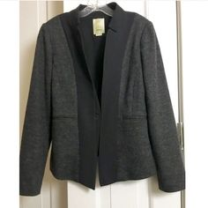 Anthropologie Elevenses blazer Anthropologie asymmetrical gray body with black Lapel with pho vest like closure. Absolutely one of the cutest jacket from anthropology. Can be worn with jeans or dress pants or over any solid color sleeveless dress for a color block look.selling elsewhere on posh for 50 bucks Anthropologie Jackets & Coats Blazers