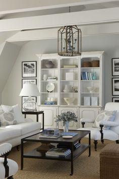 white with warm textures, white bookcase, black and white artwork, lantern