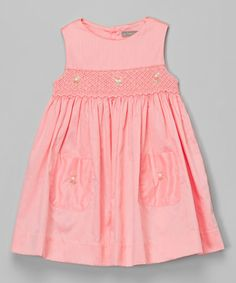 This Peach Smocked Babydoll Dress - Infant & Toddler by Les Petits Soleils by Fantaisie Kids is perfect! #zulilyfinds
