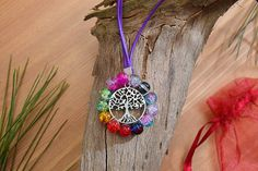 Check out this item in my Etsy shop https://www.etsy.com/listing/526943697/colorful-beaded-string-necklace-tree-of