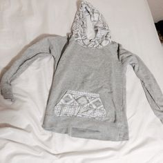 EMPYRE Aztec Hoodie! Gray and white Hoodie with Aztec patterns on the hood and pocket. Drawstring in hood. Empyre brand from Zumiez. Size M. Zumiez Tops Sweatshirts & Hoodies