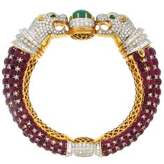 Ruby, Diamond, Emerald & Gold Panther Head Bangle | From a unique collection of vintage bangles at https://www.1stdibs.com/jewelry/bracelets/bangles/
