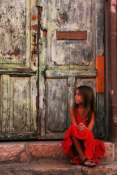 note the background color and textures that all make the girl in red so beautiful