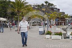 People in the Marina of Puerto Calero in Lanzarote. Canary Islands , Spain.
