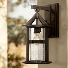 Argentine Modern Outdoor Wall Light Fixture Bronze Metal Clear Seedy Glass Cylinder for Exterior Patio Porch House - John Timberland Outdoor Wall Light Fixtures, Modern Outdoor Wall Lighting, Black Outdoor Wall Lights, Garage Lighting, Outdoor Walls, Outdoor Spaces, House Lighting, Barn Lighting, Led Outdoor Flood Lights