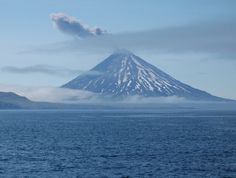Mount Cleveland erupting ash (November 16, 2010), viewed from Kagamil Island, Aleutian Islands, Alaska. / Photography by Mandy Lindeberg. Courtesy National Oceanic and Atmospheric Administration (NOAA), the National Marine Fisheries Service