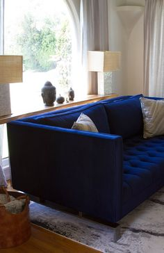 Victoria & Braden's Contemporary Family Home.                                             Had a blue couch once. Loved it and would work so well with the browns I have now.