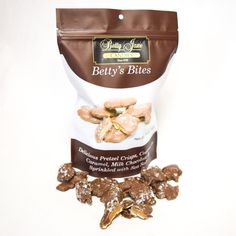 Betty's Bites! Delicious pretzel thins paired with our homemade caramel, covered in our special blend of milk chocolate and sprinkled with sea salt! 14oz resealable snack bag.