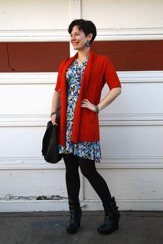 Orange cardigan, floral dress, black opaques, wedge booties