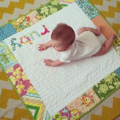 Add an applique near name. See link to source for ideas. (I think her quilt is cuter than the originals.)