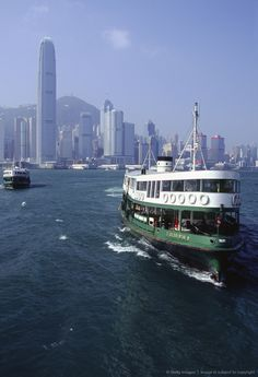 China, Hong Kong, Victoria Harbour. Star Ferries making the Victoria harbour crossing from Hong Kong Island to Kowloon.