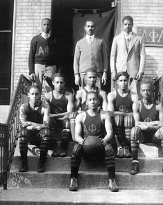"""1930's: """"First of All, Servants of All, We Shall Transcend All""""    Members of Alpha Phi Alpha Fraternity Basketball Team  Harlem, NY   Photographer: James Vander Zee"""