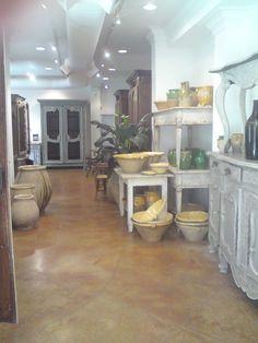 New Orleans shop in French Quarter- concrete floors, paris gray cabinets