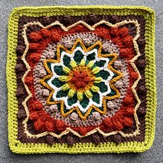 Rebirth Afghan Square - Inspired by the beautiful cherry blossoms I saw in Japan, Rebirth is a crochet square featuring a central floral and starburst pattern with surrounding popcorns. - FREE CROCHET PATTERN
