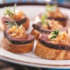 Pepper-Crusted Tenderloin Crostini Recipe -Caramelized onions add a touch of sweetness to this elegant appetizer. Use the higher range of pepper if you like a little more zip. —Taste of Home Test Kitchen