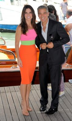 When you are wearing a stunning, colourblocked dress with an asymmetrical neckline, GEORGE CLOONEY makes a nice accessory.