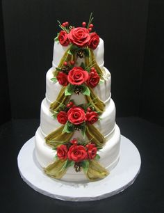 Magnificent Four Layered Round Shape Fancy White Christmas Wedding Cake With Cascade Rose Decor
