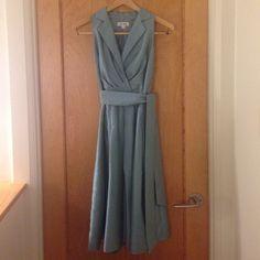 Summer Dress Jones Studio sleeveless summer dress with attached waist sash. Fully lined and hidden side zipper closure. Dresses Midi