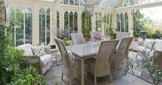Lloyd Loom Conservatory Furniture. Love the walls/windows.