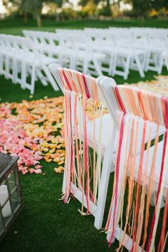 Wedding Ceremony & Aisle Decor -- Ombre Palette of pinks, peach, and orange! See more here: http://www.StyleMePretty.com/southwest-weddings/2014/03/19/budget-friendly-diy-scottsdale-country-club-wedding/ Photography: Justin & Keary Weddings