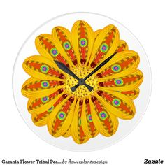 Style: Round (Large) It's time to show off your favorite art, photos, and text with a custom round wall clock from Zazzle. Featured in two sizes, this wall clock is vibrantly printed with AcryliPrint®HD process to ensure the highest quality display of any content. Order this custom round wall clock for your walls or give to friends and family as a gift for a timeless treasure. Gazania Flower Tribal Peacock
