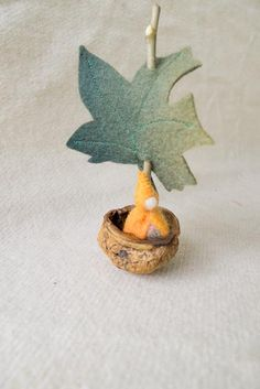 Setting sail in a nut shail? :) So cute! Adorable nut shell craft idea.