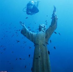 Lord of the Sea...A sunken statue of Jesus Christ stands underwater near San Fruttuoso, Italy.