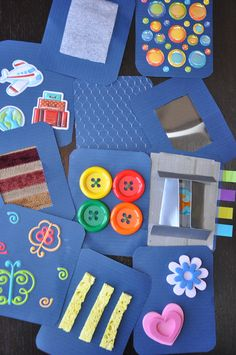 texture cards for kids.  Take a 4x4 piece of paper and add things to it for your toddlers to feel the different textures.  Ideas include sponges, buttons, puffy paints, foam stickers, dried glue.  Use what you kind find around your house.