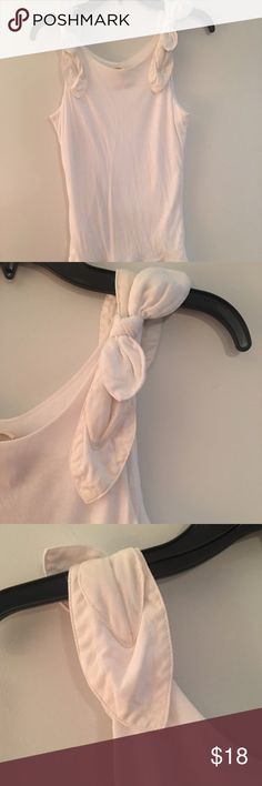 🆕Anthropologie white tank Beautiful shoulder detail on this classic white tank.  This is in good used condition with a small, barely noticeable spot on the front.  Make an offer or bundle to save 20%! Anthropologie Tops Tank Tops