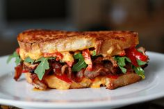 Peppery Pig Sandwiches | Grilled Cheese with Pork Tenderloin, Bacon, Arugula, Peppers & Sriracha | Fiona Likes Food