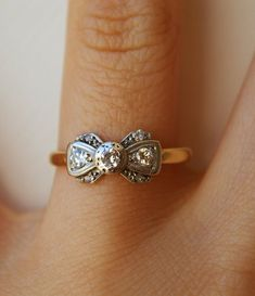 gold ring band with silver and diamond bow