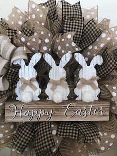Spring is in the air with this wreath! This adorable wreath is done in burlap deco mesh with a houndstooth print and white polka dot print ribbon.Centered with a trio of bunnies. Great farmhouse/country decor! Two sizes available. 22 or 25 inch