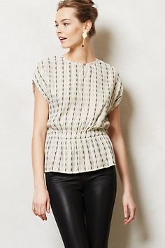 Love the shape of this blouse.