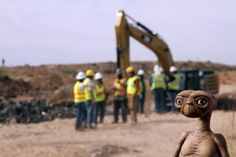 "An E.T. doll is seen while construction workers prepare to dig into a landfill in Alamogordo, N.M., Saturday, April 26, 2014. Producers of a documentary are digging in the landfill in search of millions of cartridges of the Atari 'E.T. the Extra-Terrestrial' game that has been called the worst game in the history of videogaming. A New York Times article from 1983 reported that Atari cartridges of ""E.T. The Extraterrestrial"" were dumped in the landfill in Alamogordo."