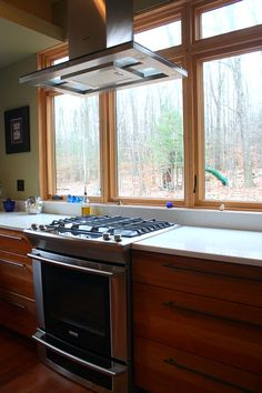 Really wish our local building codes would allow stove in front of window!