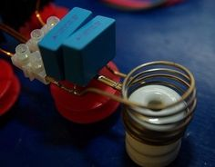 Induction Heater by RMCybernetics -- Homemade induction heater constructed from diodes, mosfets, resistors, a choke, metal coils, and a power supply. http://www.homemadetools.net/homemade-induction-heater-2