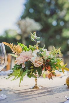 INSPIRATION for short centerpieces - With ferns, one dahlia, one rose and gold pedestal. Only thing I might change it color of flowers to something mauve.